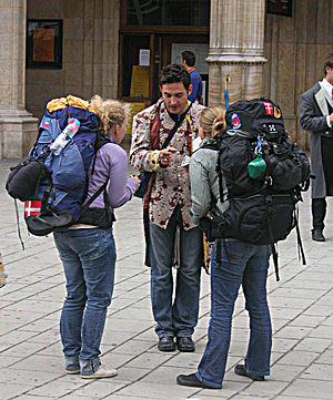 Backpacking (travel) - Two Danish backpackers in front of the Vienna State Opera in July 2005