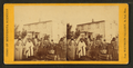 "View of a group of Indians with Europeans in the yard of ""Col. Murphy's near Shakopee"", by Whitney's Gallery.png"