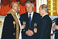Vladimir Putin with Asamineu Bedanie Aregie.jpg