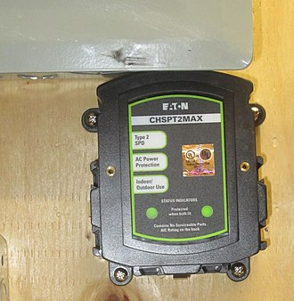 Surge protector - A surge protection device mounted on a residential circuit breaker panel