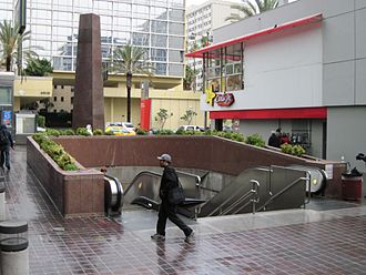 Wilshire/Normandie station - The entrance of the station. The red stand-alone sign behind the entrance in this picture uses the 2003-2014 scheme.