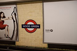 WoodGreen - Roundel and poster on westbound platform after (4570739061).jpg