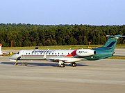 ExpressJet Embraer Regional Jet parked at Raleigh Durham International Airport.