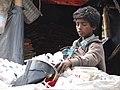 Young Boy with Plastic Bottles - Along Buriganga River Embankment - Dhaka - Bangladesh (12831217045).jpg
