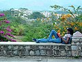 Young Woman Reads a Book Overlooking Santiago de Cuba - Cuba.jpg