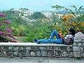 Young Woman Reads a Book Overlooking Santiago de Cuba - Cuba.jpg