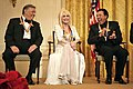 Zubin Mehta laughs with singers Dolly Parton and William Smokey Robinson during a reception for the Kennedy Center honorees.jpg