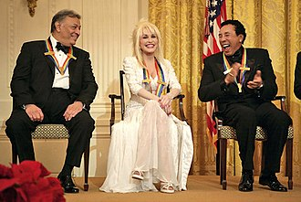 Smokey Robinson - Conductor Zubin Mehta laughs with singers Dolly Parton and Robinson during a reception for the Kennedy Center honorees in the East Room of the White House on Sunday, December 3, 2006.