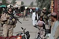 100802-M-0301S-106 HM2 Claire E. Ballante, left, assigned to the Female Engagement Team (FET), patrols with 1st Battalion 2d Marines in Musa Qa'leh, Afghanistan.jpg