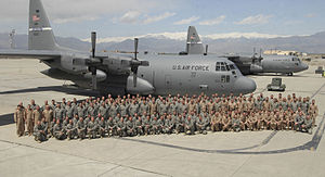 123d Airlift Wing - Deployed U.S. Air Force members of the 123rd Airlift Wing, Kentucky Air National Guard, pose with their Lockheed C-130H Hercules aircraft (s/n 91–1232, 91–1233) on a flightline in Afghanistan, 22 April 2009.