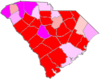 Red counties were won by Moses and magenta counties were won by Tomlinson