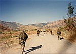1st Platoon, A Company, 1st Battalion, 3rd Marines on the move at Green Beach, Philippines in December 1989.jpg