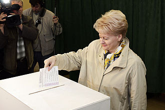 Elections in Lithuania - Dalia Grybauskaitė casting a vote in the 2009 presidential election