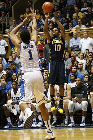 Derrick Walton - Walton shoots over Jabari Parker of Duke