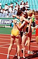 261000 - Athletics track Lisa Llorens Sharon Rackham hug - 3b - 2000 Sydney race photo.jpg