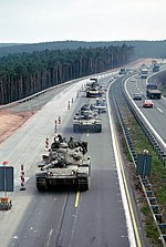 3rd Armored Division M60A3 tanks and armored personnel carriers near the Sembach Air Base exit ramp DF-ST-83-05568