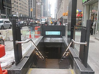 57th Street (IND Sixth Avenue Line) - Street entrances before renovation (left) and afterward (right)
