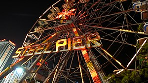 Steel Pier - Steel Pier Ferris Wheel in Atlantic City with Trump Taj Mahal in background in 2009.