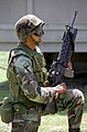 AIRMAN Mathew Rizzo, a 30th Security Forces team member wears eye protection, canteen belt and a field vest, as he holds his M16A2 rifle and M203 Grenade Launcher.jpg