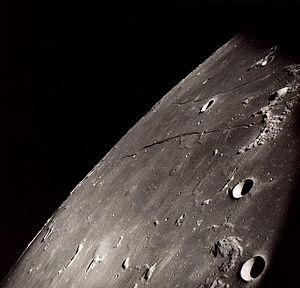 Cauchy (crater) - Cauchy is in the upper right quadrant between Rupes Cauchy and Rimae Cauchy in this Apollo 8 image.  Omega and Tau Cauchy are visible below the Rupes Cauchy.