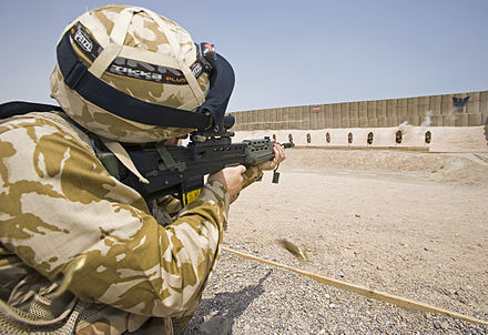 A British soldier aims on a shooting range in Iraq, 29 July 2006. A British soldier aims his SA80 rifle on a shooting range at Basra, Iraq. MOD 45148015.jpg