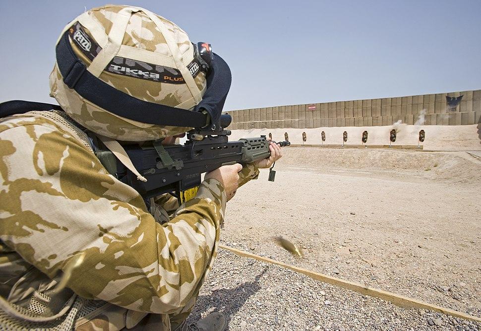 A British soldier aims his SA80 rifle on a shooting range at Basra, Iraq. MOD 45148015