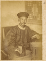 A Chinese Man in Silk Brocade Jacket and Plain Gown. China, 1874-75 WDL4138.png