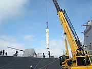 A Crane lifts an Evolved Sea Sparrow Missile (ESSM) aboard the guided missile destroyer USS McCampbell