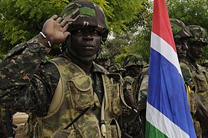 Gambia Armed Forces - Image: A Gambian soldier salutes during Senegal's national anthem during the opening ceremonies for Western Accord 2012 in Thies, Senegal, June 9, 2012 120609 Z KE462 133