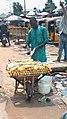 A Nigerian man selling sugar canes.jpeg