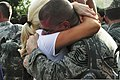 A U.S. Airman from the 169th Fighter Wing gives a hug after returning from Iraq Aug. 29, 2010, at McEntire Joint National Guard Base, S.C 100829-F-XH297-007.jpg