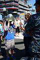 A guest touring the aircraft carrier USS Ronald Reagan (CVN 76) dons a firefighting helmet 130921-N-TO979-023.jpg