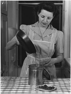 Ann Rosener - Image: A soldier of the home front saves all waste fats and greases so that they can be processed into ammunition for... NARA 196420