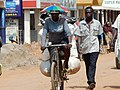 A woman rides with goods on her bicycle to Arua market in Northwestern Uganda to look for survival. PHOTO BY FELIX WAROM OKELLO.jpg