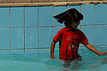 A young Iraqi girl enjoys the new swimming pool that opened in Risalah, Baghdad, Iraq, Sept. 18, 2008 080918-N-KM397-051.jpg