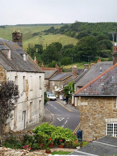 Abbotsbury. Undoubtedly one of England's most interesting villages. This is the junction of Church Street with the B3157 as it bends into Market Street, seen from the churchyard.