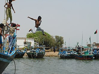 Free will - A photo showing a boy jumping into a body of water. It is widely believed that humans make decisions (e.g. jumping in the water) based on free will.