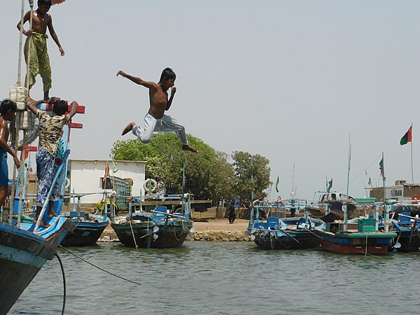 A photo showing a boy jumping into a body of water. It is widely believed that humans make decisions (e.g. jumping in the water) based on free will. Abm2.jpg