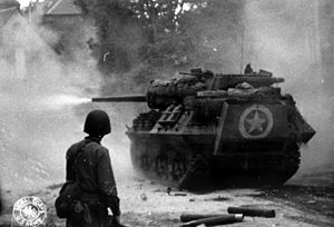 M10 tank destroyer - M10 in action near Saint-Lô, June 1944.