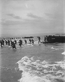 American troops leap forward to storm a North African beach.jpg
