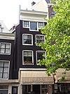 foto van Huis met latere gevel onder rechte lijst