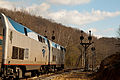 Amtrak and CPL's in Magnolia, WV (5632548245).jpg