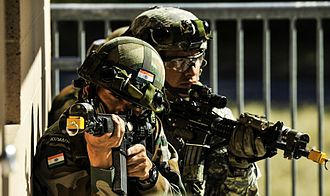 Kumaon Regiment - Indian soldiers from the 6th Battalion of the 6th Kumaon Regiment pulls security before entering a room while conducting company movement procedures with the United States Army during the Yudh Abhyas 2015 at Joint Base Lewis-McChord, Washington.