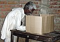 An old man casting his vote in 2nd phase of Assam Assembly Election-2006 at Rupahi, Nowgaon, Assam on April 10, 2006.jpg