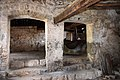 Ancient oil press in olive oil production workshop in Trsteno 16.jpg