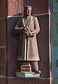 Angestelltenfigur am Eingangsbauwerk der ehemaligen Margarinefabrik Voss.jpg