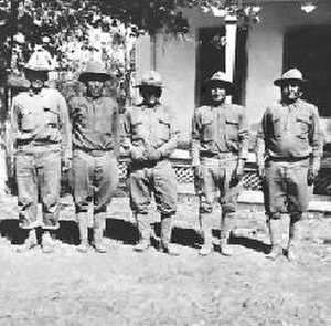 Battleground Gunfight - From left to right, First Sergeant Chicken, Jesse Palmer, Tea Square, Sergeant Big Chow, and Corporal C. F. Josh at Fort Apache in 1919.