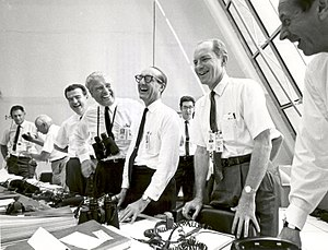 George Mueller (NASA) - Charles W. Mathews (Deputy Associate Administrator, Office of Manned Space Flight), Dr. Wernher von Braun  (Director, Marshall Space Flight Center), George Mueller, and Lt. Gen. Samuel C. Phillips (Director, Apollo Program) after the Apollo 11 liftoff.