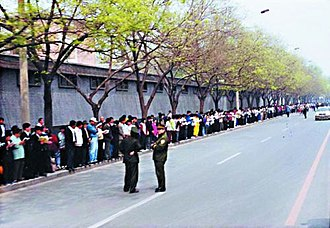 Falun Gong practitioners demonstrating outside the Zhongnanhai government compound in April 1999 to request an end to official harassment of Falun Gong practitioners. Soon thereafter, a nationwide persecution of the practice began. April25Zhognanhai.jpg