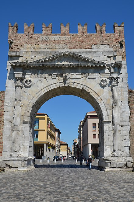 The Arch of Augustus in Rimini (Ariminum), dedicated to Augustus by the Roman Senate in 27 BC, the oldest surviving Roman triumphal arch Arch of Augustus at Ariminum, dedicated to the Emperor Augustus by the Roman Senate in 27 BC, the oldest Roman arch which survives, Rimini, Italy (19948839545).jpg